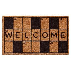 Extend a warm greeting to your guests with this lovely coir doormat, featuring a playful crossword print.  Product: Doormat...