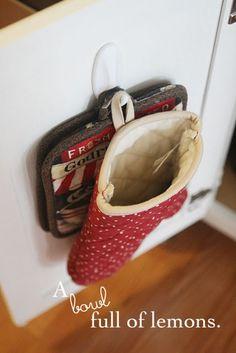 Pot holders on a hook, inside a cabinet door, right next to the oven. Better than floating around the kitchen which is how they are now.