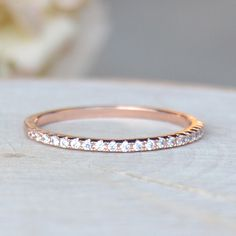 This ring is a gorgeous micro-pave eternity ring. This eternity band is ultra thin and has white stones covering half of the band. Looks great on on its own or stacked! Rose Gold Plated brass with whi