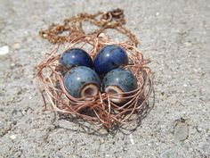Copper bird's nest necklace- blue speckled beads