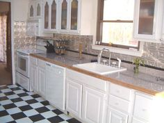 White Kitchen With Checkered Floor And Metal Backsplash