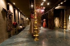 *An Indian By Design Exclusive* Presenting the first pictures of the new Rohit Bal Store, at Emporio in New Delhi. The store evokes a sense of grungy grandeur, and the gold and mirror and jaali wor…