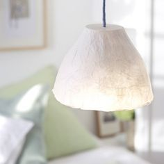 How to make a papier-mâché light shade: Add soft illumination to a bedroom or dining area with a papier-mâché shade. Delicate layers of wafer-thin tissue paper are glued together over a plastic bowl mould, then dried and hung on a standard light fitting.
