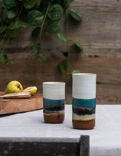 These handmade ceramic tumblers are artfully crafted by a husband and wife team, Blue Eagle Pottery. Made of stoneware clay and hand thrown on the wheel, the tumblers are glazed a warm soft white colo