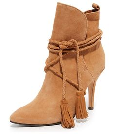 Fadhila booties by Schutz. Braided ties with tassel accents close the split cuff on these suede, pointed toe Schutz booties....