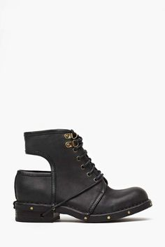 Insanely cool black leather combat boots featuring a cutout back and brass rivet detailing. Lace-up front that wraps around and laces through heel, leather interior. Perfect paired with a flowy dress and circle sunnies! By Jeffrey Campbell.