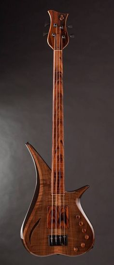 Marozi 4 String Fretless by BL Design Custom Bass Guitars I'm a huge fretless fan I have a Yamaha RBX fretless, but this is beautiful.