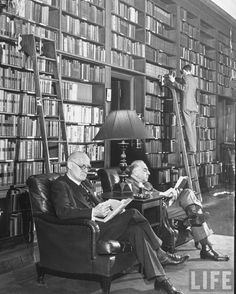 U.S. Reading at the Harvard club.  New York, NY (1940). Photographer: Alfred Eisenstaedt