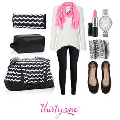 We love how our stylists added a pop of color to this black and white outfit, featuring the Retro Metro Weekender!