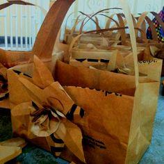 Paper bag baskets & flowers for center pieces!