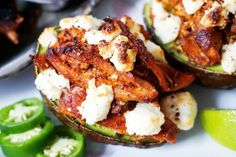 Fast and Easy – 3 Ingredients! To pull off this impressive stuffed avocado recipe all you're going to need is 3 ingredients. You'll need an avocado, some cheese, and our Mexican shredded chicken! Fine, maybe you don't need our shredded chicken, but it sure does take these stuffed avocados to the next level! The Chicken …