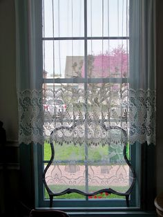 Pretty lace curtains and lace panel in Dutch window.