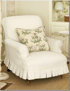 This beautiful Ross designed slip has short pleats which shows off the chair's charming wheeled feet!