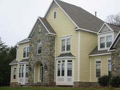 Colonial Remodeling stone veneer siding plus james hardie siding installedcolonial