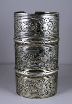 This is an absolutely massive Egyptian cuff. The design is all engraved by hand and the work is extraordinary. It was made by Osta Abraham, a Tunisian Jew who settled in Egypt and catered to the needs of the western desert oases (such as Siwa) and Bedouin tribes. When worn it takes up more than half of my forearm. About 260 grams.