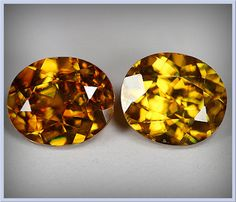 Rich Honey Glittering Twinkling Sphene Gem Pair 6 x 5mm  A gorgeous Sphene pair  - 1.80cts  VVS clarity  Shimmering luster.  100% natural mined   -  untreated.  Origin: Russia