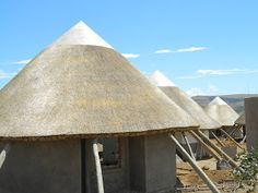 We currently have a thatching team in Mvezo - the birthplace of Nelson Mandela, near Mthatha in the Eastern Cape of South Africa, where a bi. Village House Design, Village Houses, Thatched House, Thatched Roof, Circular Buildings, 2 Bedroom House Plans, Spa, Glass Design, My House
