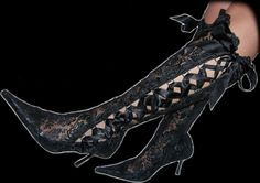 Amazing black knee boots made of lace.. Cute ;)  fashion-heights.com