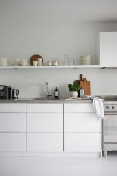 Concrete kitchen counters  White kitchen cabinets  Open shelving s/w wall