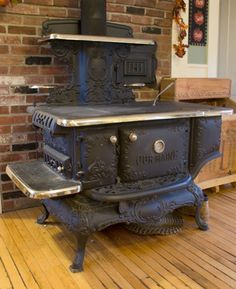 Our grandmother cooked on and heated her kitchen with a wood burning stove. Imagine how fascinated we city kids were.she never had to put a stick of wood in the stove herself when we we visiting! Antique Wood Stove, How To Antique Wood, Old Wood, Vintage Wood, Vintage Kitchen, Wood Burning Cook Stove, Wood Stove Cooking, Kitchen Stove, Kitchen Wood
