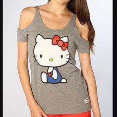 Vans Hello Kitty Misfit Cold Shoulder Tee Gray M This is a like-new (worn 2 times) Vans Hello Kitty Misfit Cold Shoulder Tee in Gray Size Medium. I purchased this at the Vans store in Southlake, TX and it is in excellent condition. Super cute!  Vans Tops Tees - Short Sleeve