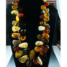 Beautiful Baltic Amber drop nugget necklace at 22 inches long. Necklace features an amber screw clasp at the back. Beads are graduated in size, the smallest at 12 x 15 mm and the largest at 26 x 30mm.