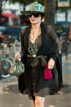Catherine Baba She makes it work This looks like a chiffon scarf or shawl.