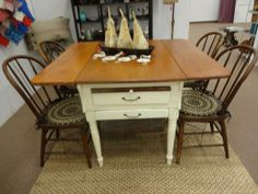 $1895 - This antique Bakers Table has two drop leaves and four antique chairs to complete the set. ***** In Booth L111 at Main Street Antique Row 7336 E Main St (east of Power RD on MAIN STREET) Mesa Az 85207 **** Open 7 days a week 10:00AM-5:30PM **** Call for more information 480 924 1133 **** We Accept cash, debit, VISA, MasterCard or Discover.
