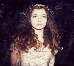 Mia Sara [looks like a polaroid taken on the set of Legend after her character's costume became...distressed]