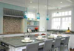 White + aqua/turquoise kitchen. Huge island. So pretty. House of Turquoise.