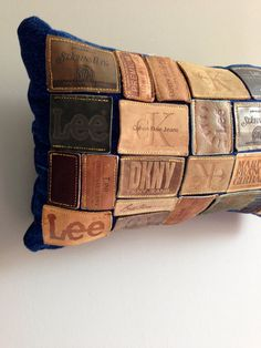 denim leather jean label pillow by TegansCloset on Etsy, $65.00 - Would be a royal pain in the ass to put together but it's a great idea!