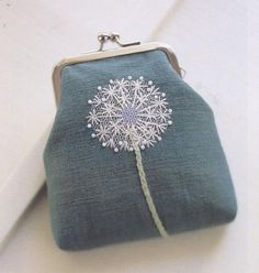 Plain little purse with some lovely and whimsical embroidery added!