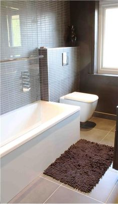 Love the clean lines of this bathroom.  And a square toilet...very cool.
