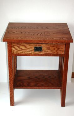 this is a solid oak mission end table or night stand 15 x15x 28 inches tall price listed is a fake non function drawer with this is hand crafted 100% solid oak stained and 3 coats of lacquer this will be made to order your choice of stain color the table pictured is larger than the one in this listing some assembly will be required production is,1 to 2 weeks but often sooner message me for estamated build time if your in a rush The table pictured is 16deep 19wide 28 tall can also custom make…