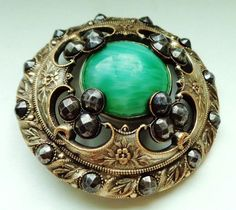 "large antique ""Gay 90's"" button : olive green glass center stone and cut steel accents"