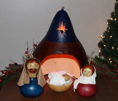 "Our stunning heirloom quality gourd Nativity set is like no other.  Handcrafted with great attention to detail, the warm glow of the amber electric light brings the Holy Family to life and illuminates the cut out star.  Start a new Christmas tradition with this impressive and unique 5 piece set!Includes: The Holy Family- Joseph (approximately 3 ½"" in diameter), Mary (approximately 3"" in diameter), Baby Jesus (approximately 1"" in diameter), Manger (approximately 4"" in diameter), Crèche…"