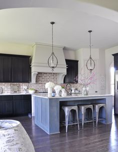 Beautiful kitchen with blue island. Love the vent hood!