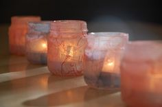 Baby food candle jars...empty jars, mod podge, glitter and tissue paper...easy peasy
