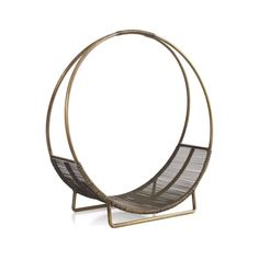 Hoop-shaped holder stacks a clean round of logs, with a basket-like bottom to hold in stray twigs and bark.  Handcrafted of iron with antiqued brass and clear powdercoat finishes. HandcraftedIron with antiqued brass finish and clear powdercoatFor indoor use onlyMade in India.
