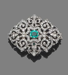 A late century emerald and diamond brooch. The fine openwork rose-cut diamond cartouche, centrally-set with a cut-cornered step-cut emerald, mounted in silver and gold, length Art Deco Jewelry, Modern Jewelry, Fine Jewelry, Jewelry Design, Jewellery, Edwardian Jewelry, Antique Jewelry, Vintage Jewelry, Diamond Brooch
