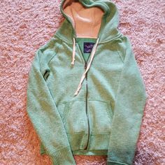 American Eagle zipper up Light green with sherpa lined hood. In good condition!!! American Eagle Outfitters Tops Sweatshirts & Hoodies