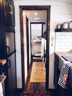 This old school bus was converted into a luxury tiny home on wheels. The kitchen has stunning fixtures and appliances, the bedroom has a boho and farmhouse modern feel and the living room area is extra cozy. Cozy Living Spaces, Tiny House Living, Living Room, Small Houses On Wheels, Old School Bus, Tiny House Luxury, Bus House, White Shiplap, Bus Conversion