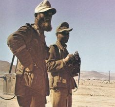 A scruffy looking Afrika Korps soldier alongside his comrade in the searing deserts of North Africa. 1942.