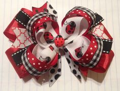 Ladybug Stacked Hair Bow - red, black, and white! Your Bow: ❤️ Measures about inches ❤️ is attached to an Alligator clip partially lined in coordinating ribbon ❤️ has heat sealed ribbon ends to prevent fraying ❤️ has a ladybug button accent Stacked Hair, Red Black, Black And White, Making Hair Bows, Boutique Bows, Hair Pieces, Burlap Wreath, My Etsy Shop, Fascinators