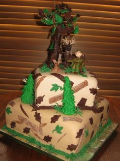 Deer Hunting Cake - Deer Hunting Cake with modeling chocolate oak tree and deer. The man and other trees are made from fondant. The cake is covered with mmf.