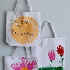Kids can craft up a personalized tote bag with their handprints for mom, with this seriously-couldn't-be-simpler project.