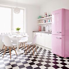 Pink fridge and checkerboard flooring