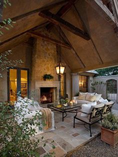 Outdoor patio entertainment area with tiled floor and fireplace