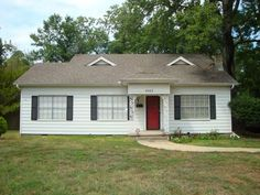 3003 Olive, Texarkana TX 75501 - Home is centrally located, TISD, large two bedroom, two-half bath, two living areas, open living area to kitchen, fireplace in family room, nice size fenced yard, and carport.