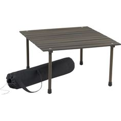 A low, folding table for picnics with a carrying case.  It'd be a step above keeping your food on the ground.